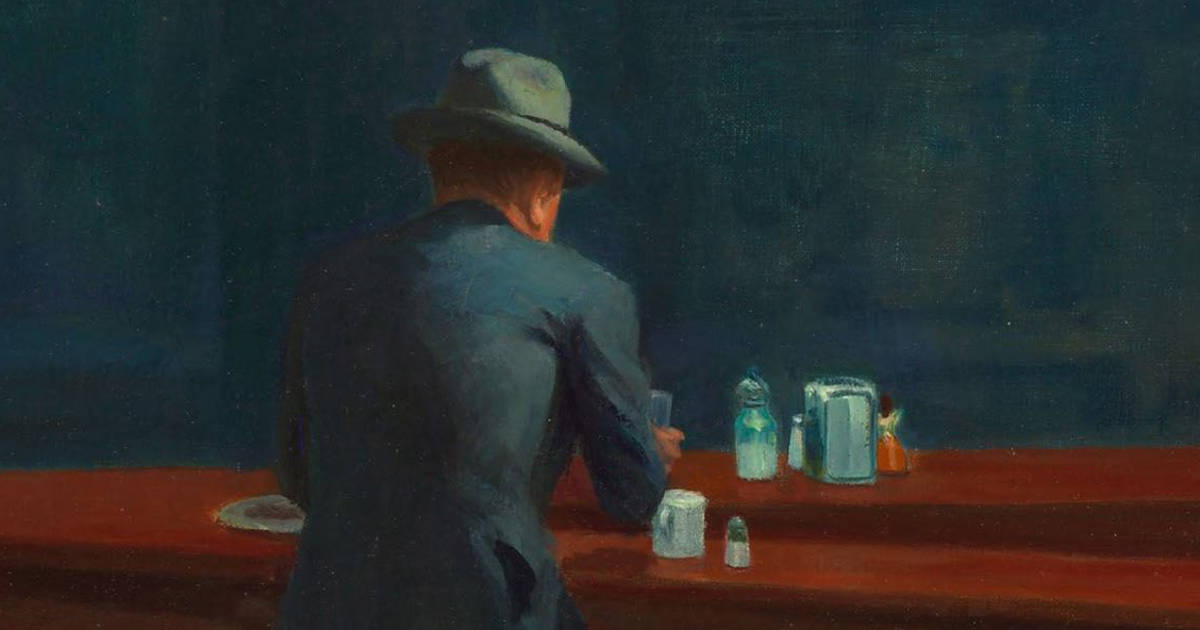 A crop of Hopper's Nighthawks, showing a man in a suit sitting alone at the counter of a diner.