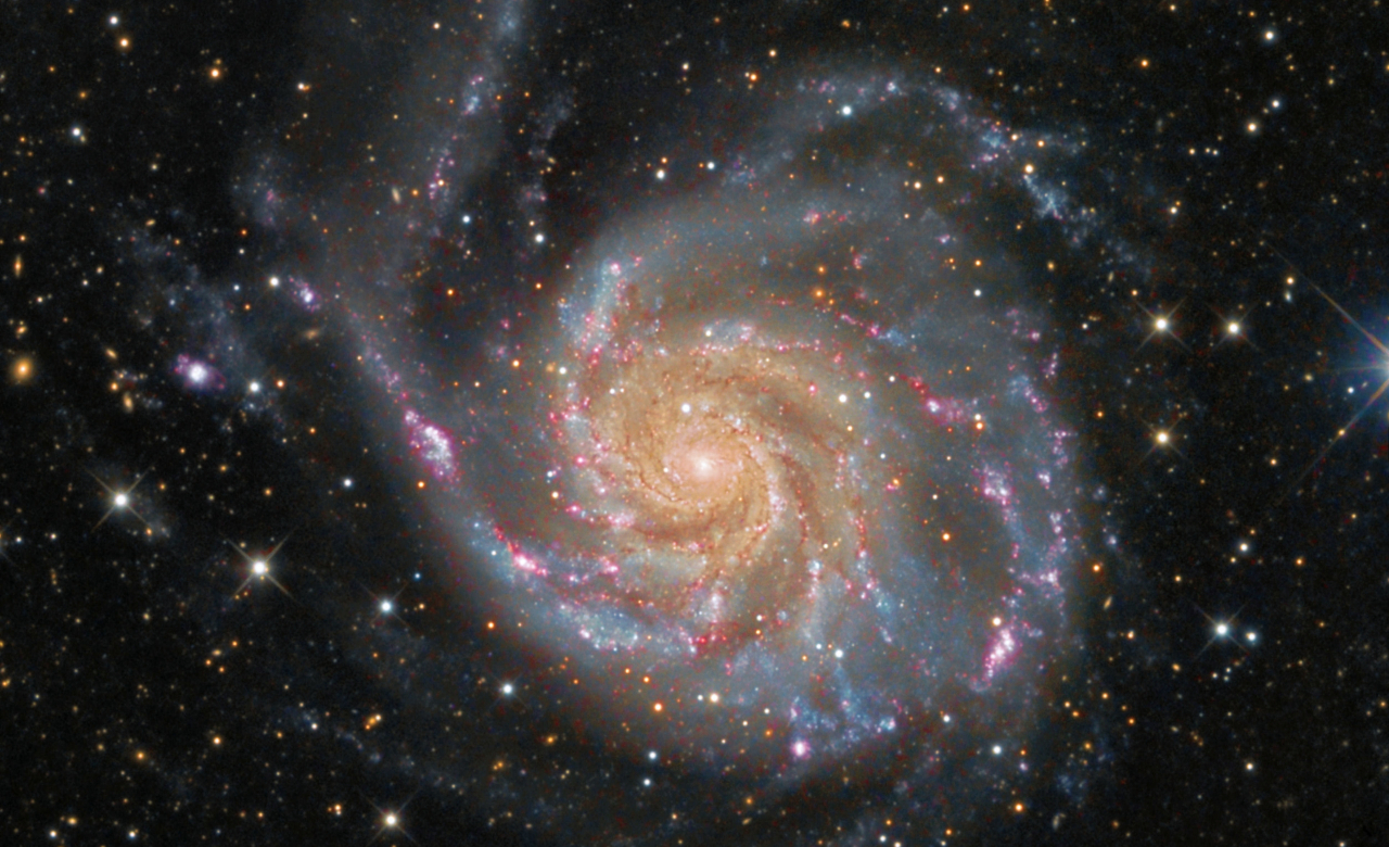 A color image of the M101 Pinwheel Galaxy, a spiral galaxy, composed of multiple exposures taken by NASA and the European Space Agency.