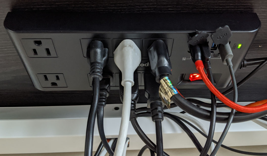 The freeport powerstrip mounted under the desk.