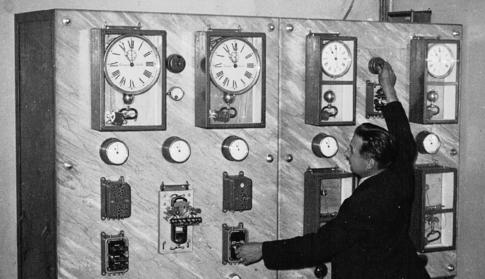 A man adjusts the central time of the Gare Saint-Lazare in Paris, 1937.